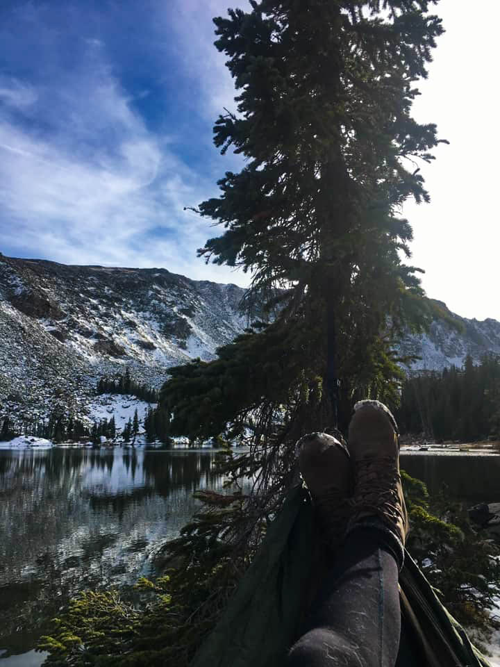 Feet kicked up in a hammock on the top of Diamond Lake, Colorado