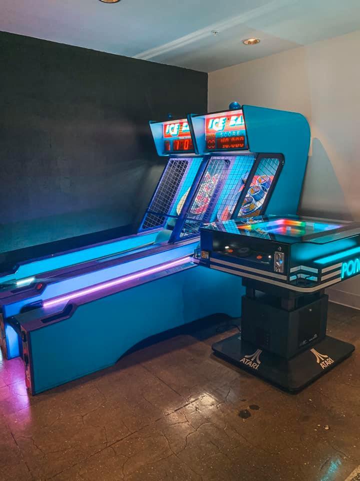 Two retro skeeball tables alongside classic pong