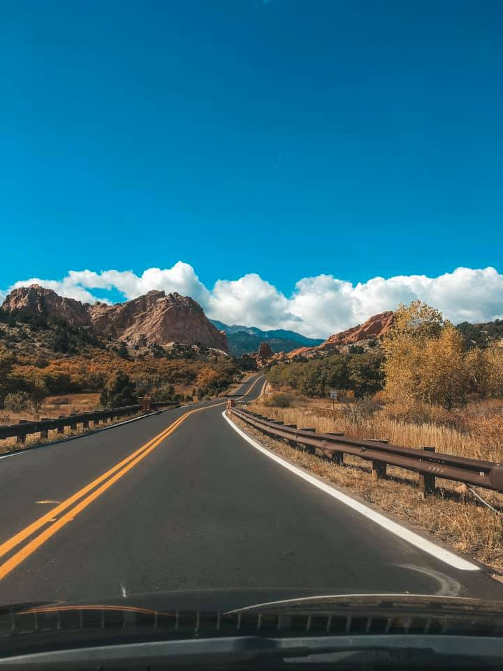 Solo traveler driving down the open roads of Colorado