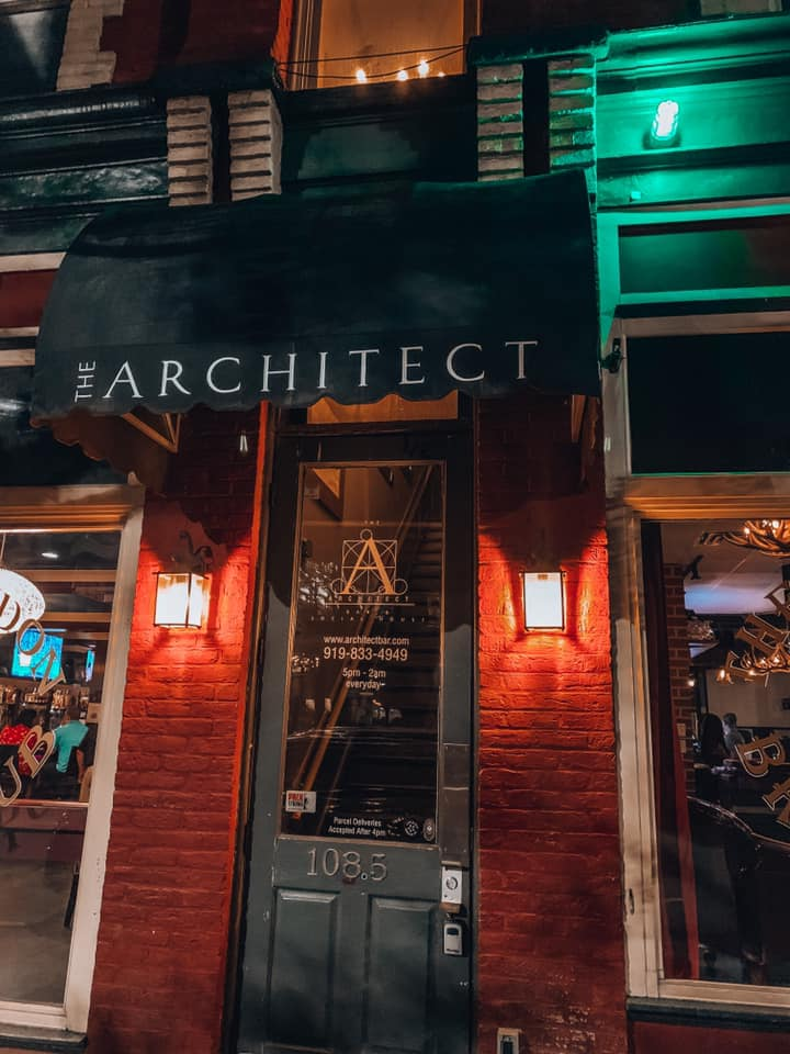 "awning that says ""The Architect"" with a green light turned on next to it"