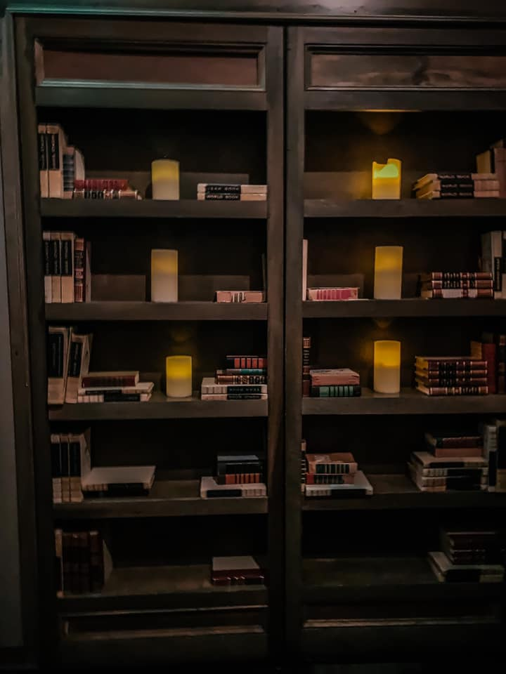 book shelves that double as a secret door into a speakeasy in downtown raleigh