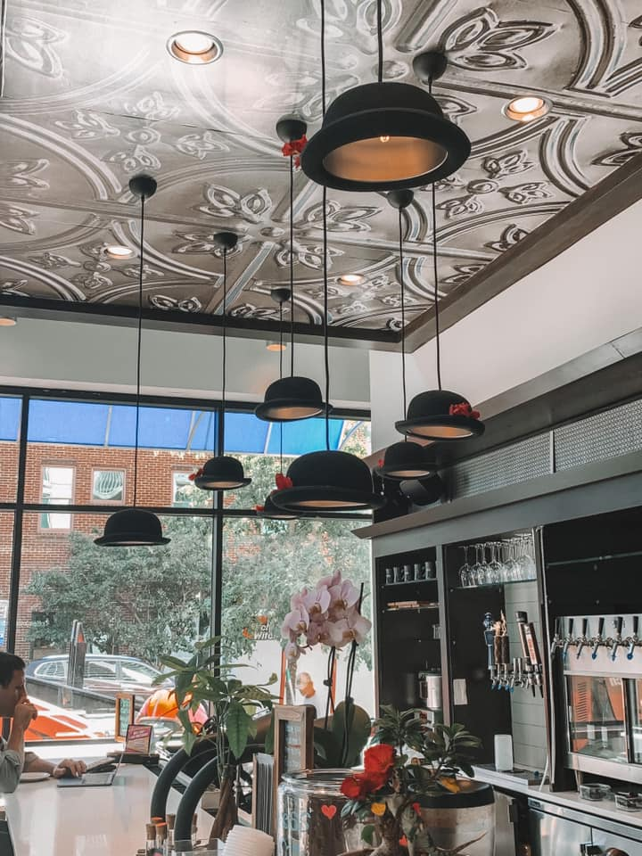 hat light fixtures hanging from the ceiling at 42 & Lawrence
