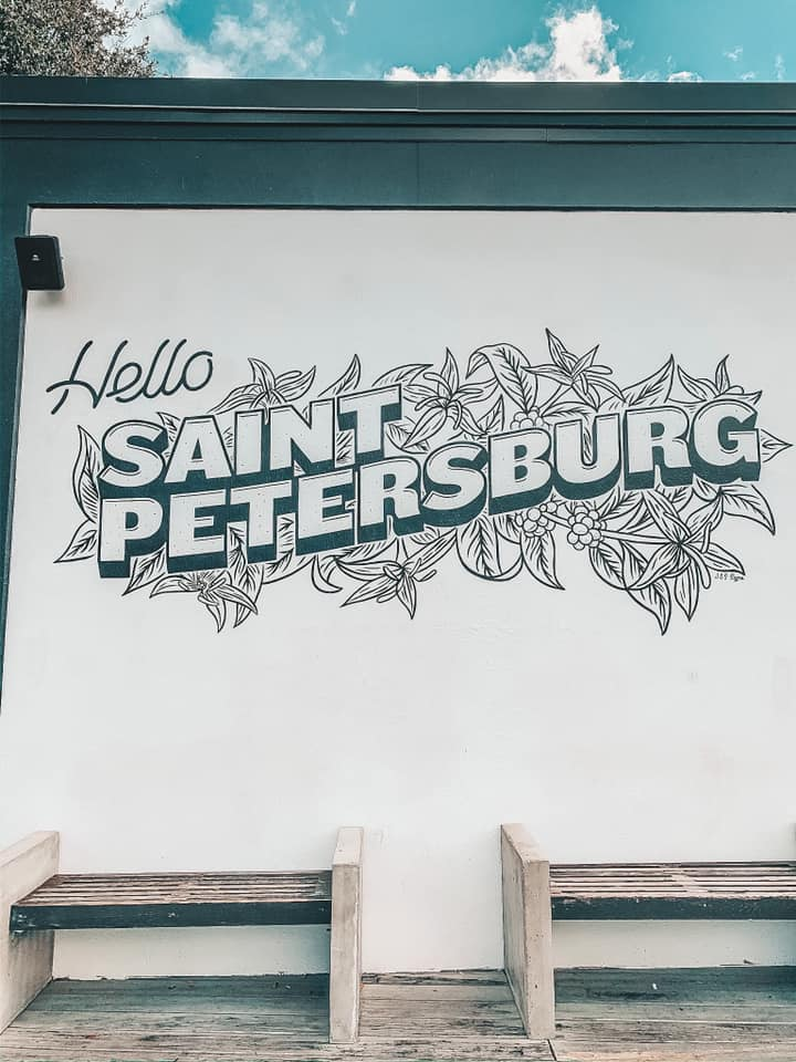"""""""hello Saint Petersburg"""" mural on the outside of a coffee shop"""