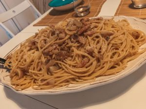 must try foods in Italy, a heaping pile of plated carbonara