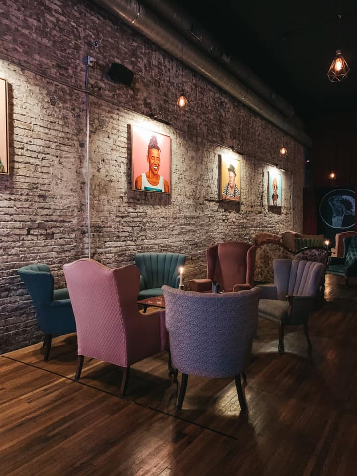 Seating and wall art at Unknown Caller Chattanooga