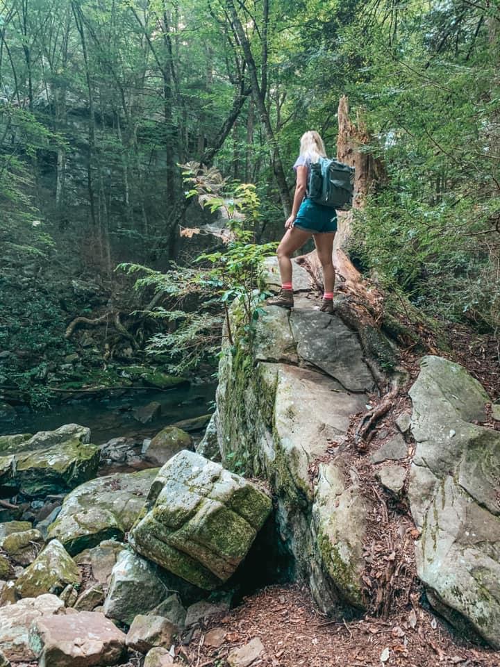 Climbing a giant rock at Foster Falls