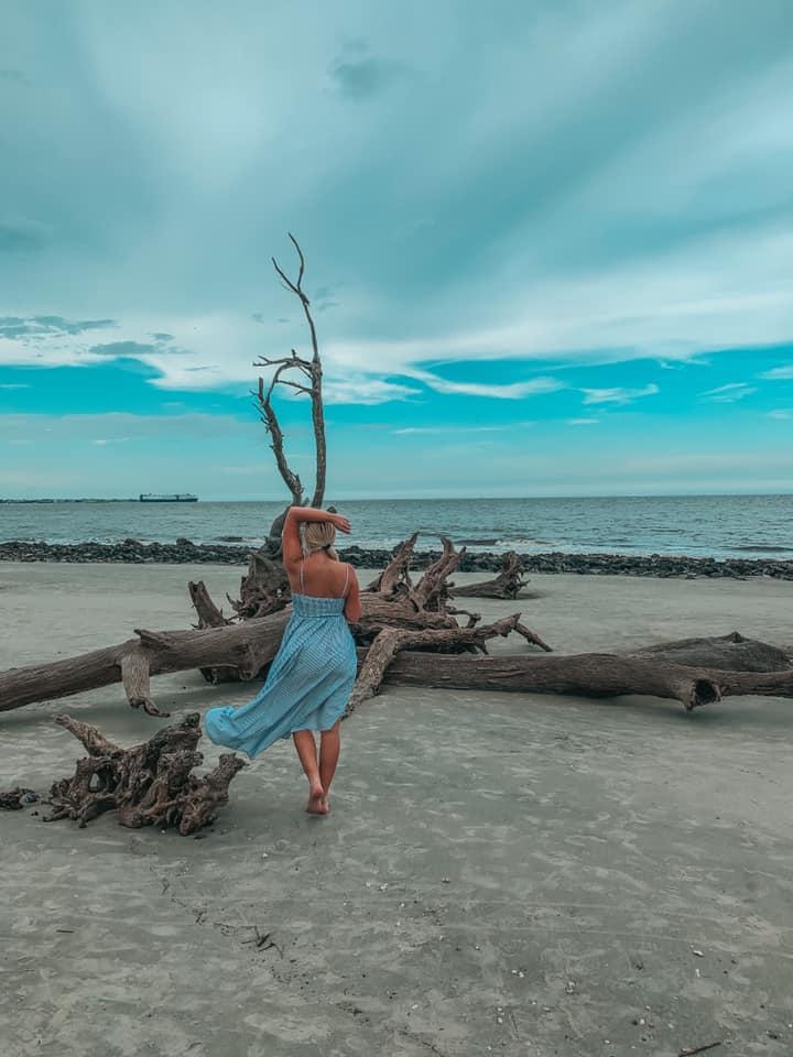 walking along Driftwood Beach on Jekyll Island, Georgia