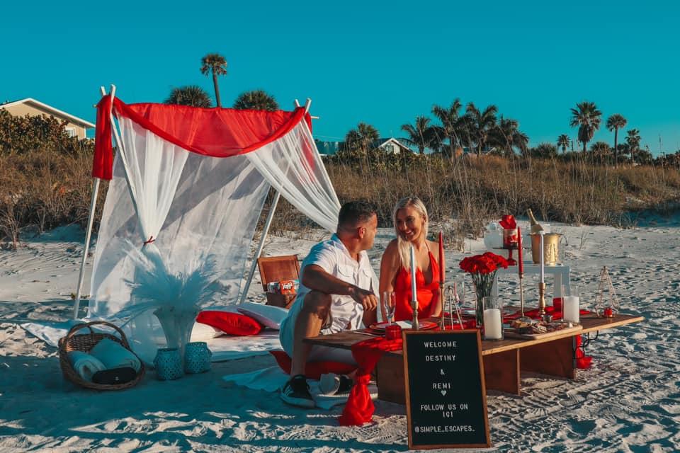 Couple on romantic beach picnic date. Romantic date idea for Tampa Bay