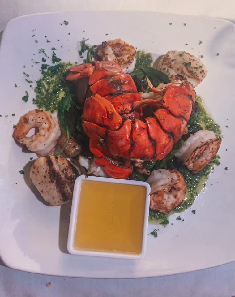 Lobster, scallops, and shrimp from Duval's Fresh. Local. Seafood. beautifully plated