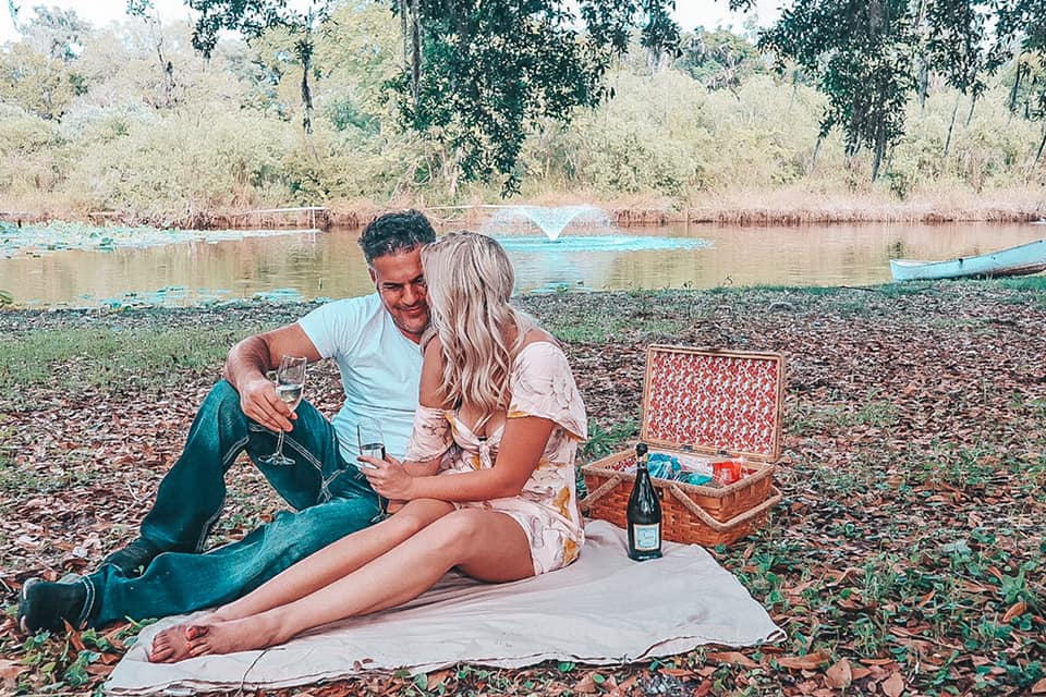 Couple enjoying a picnic together at a beautiful Airbnb in Ocala, Florida for a nice weekend getaway