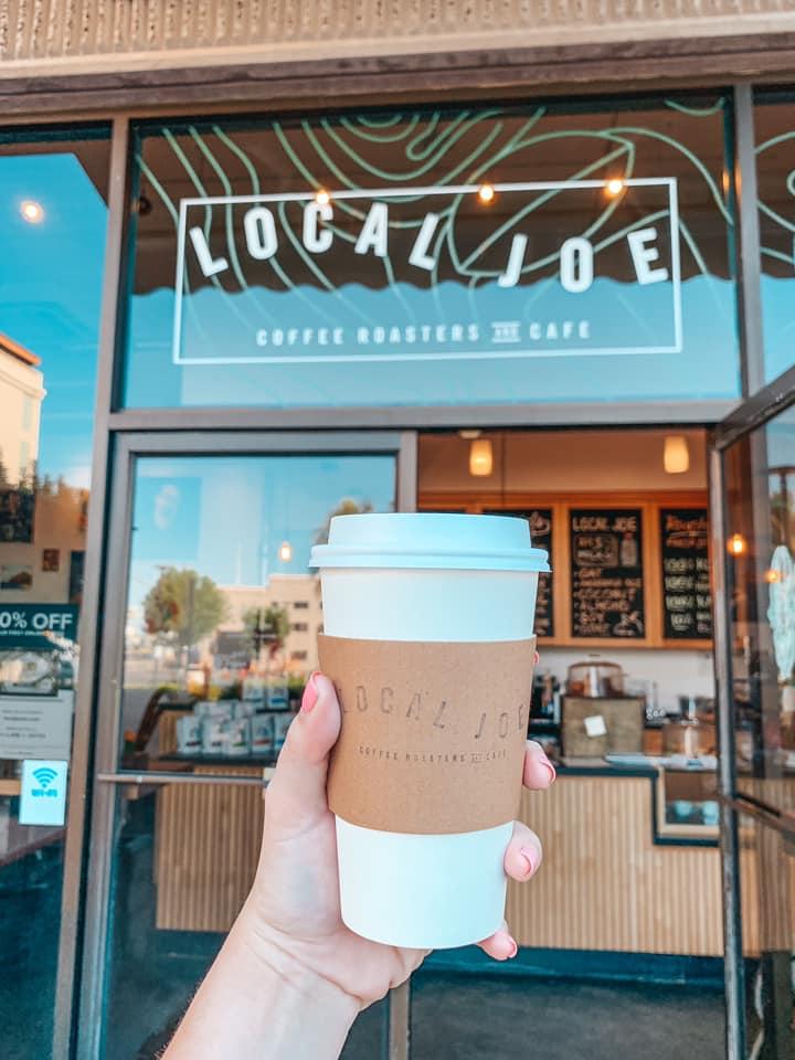 Holding latte in front of Local Joe in Honolulu