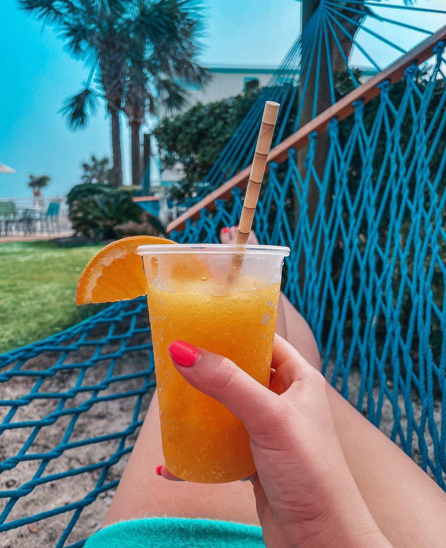 Relaxing on hammock at Holiday Inn Express  Orange Beach enjoying a mango colada