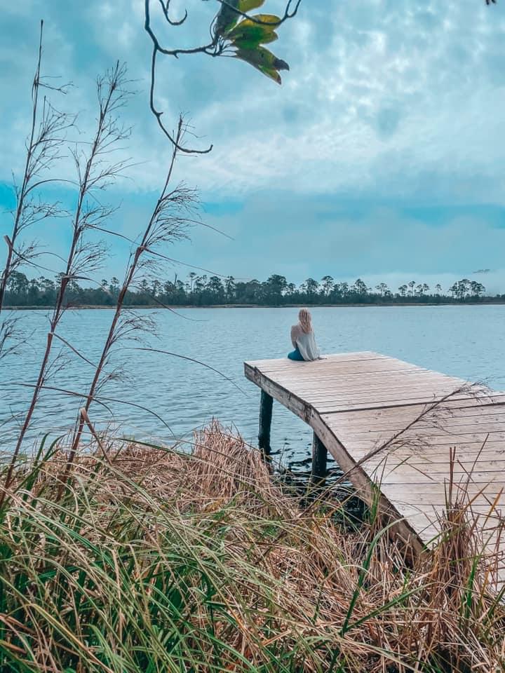 Sitting on a dock at a lake in Gulf State Park in Orange Beach, Alabama
