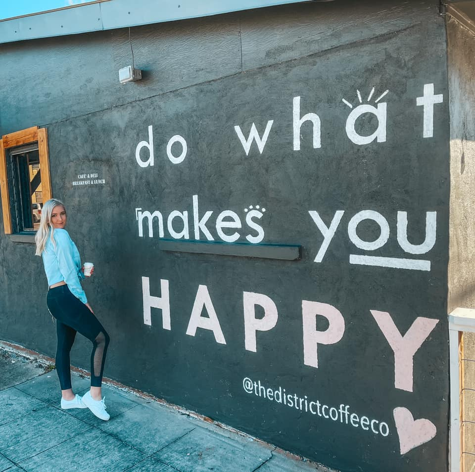 "mural that reads ""do what makes you happy"" outside of The District Coffee Co"
