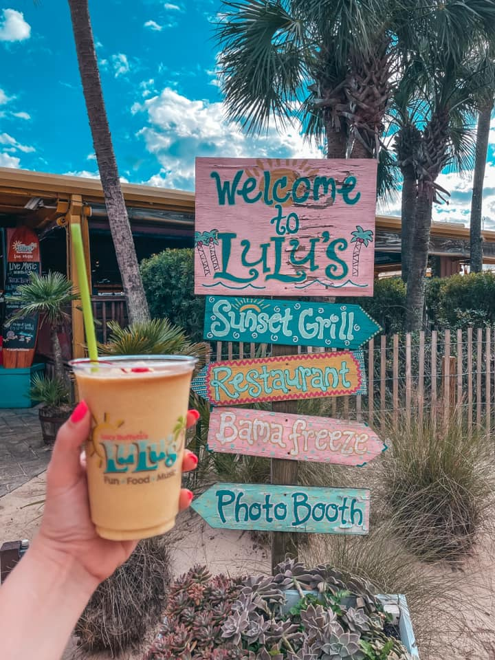 """Mango pina colada and Lulu's colorful signage that says """"Welcome to Lulu's"""""""