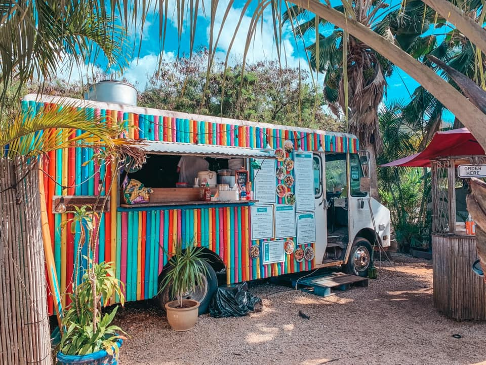 Brightly colored food truck on North Shore Aji Limo