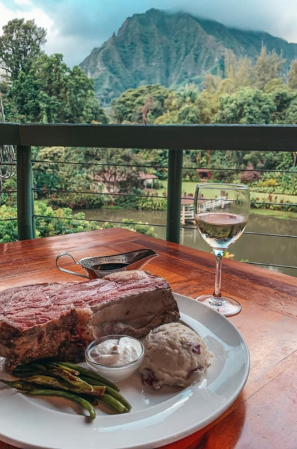 Prime rib, glass of wine, and beautiful mountain views in oahu